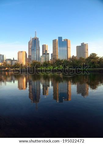 melbourne city reflected in the yarra river - stock photo