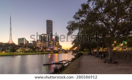 Melbourne City Skyline, Eureka tower and State Theatre from Birrarung Marr Park across Yarra river at dusk in Summer, Australia - stock photo