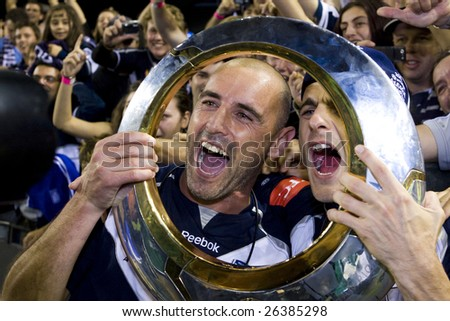 MELBOURNE - FEB 28: A-league Major Grand Final - Melbourne Victory defeat Adelaide United 1-0 on February 28, 2009 in Melbourne, Australia. Kevin Muscat and Tomislav Pondeljak celebrate their trophy. - stock photo