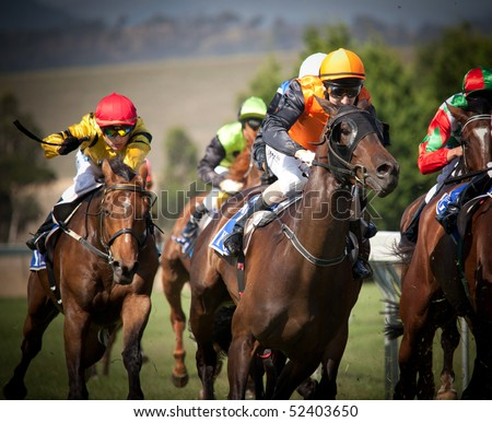 MELBOURNE - FEBRUARY 21: Horses enter the straight in the De Bortoli Plate, won by On the Scoot at Yarra Glen on February 21, 2010 near Melbourne, Australia. - stock photo