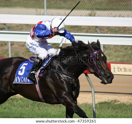 MELBOURNE - FEBRUARY 21: Sensational News is ridden to the line to finish a close second to Madam Melba in the Windy Peak Maiden at Yarra Glen on February 21, 2010 near Melbourne, Australia. - stock photo