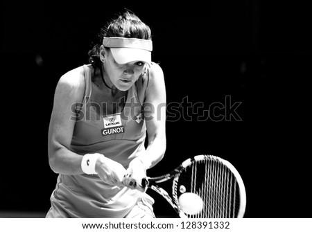 MELBOURNE - JANUARY 22: Agnieszka Radwanska of Poland in her quarter final loss to Li Na of China at the 2013 Australian Open on January 22, 2013 in Melbourne, Australia. - stock photo