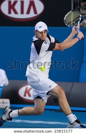 MELBOURNE - JANUARY 23: Andy Roddick of the USA returns a serve at the Australian Open Tennis Grand Slam Event on January 23, 2009 in Melbourne. - stock photo