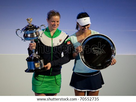 MELBOURNE - JANUARY 29: 2011 Australian Open singles champion Kim Clijsters of Belgium (L) with runner up, Li Na of China on January 29, 2011 in Melbourne, Australia. - stock photo