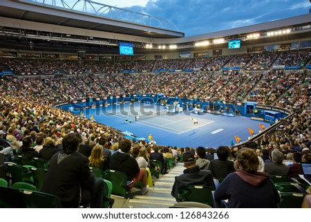 MELBOURNE - JANUARY 26: Crowd at Rod Laver Arena during the 2013 Australian Open Womens Championship Final on January 26, 2013 in Melbourne, Australia. - stock photo
