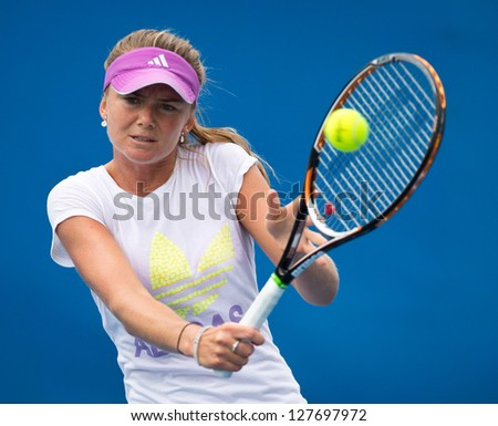 MELBOURNE - JANUARY 12: Daniela Hantuchova of Slovakia in a practice session at the 2013 Australian Open on January 12, 2013 in Melbourne, Australia. - stock photo