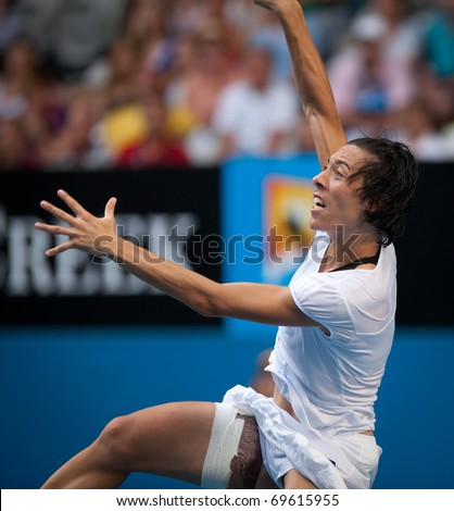 MELBOURNE - JANUARY 23: Francesca Schiavone of Italy in her marathon fourth round win over Svetlana Kuznetsova of Russia in the 2011 Australian Open on January 23, 2011 in Melbourne, Australia - stock photo
