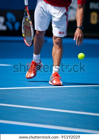 MELBOURNE - JANUARY 25: Kei Nishikori of Japan in his quarter final loss to Andy Murray of Great Britain at  the 2012 Australian Open on January 25, 2012 in Melbourne, Australia. - stock photo