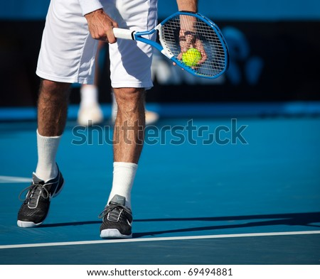 MELBOURNE - JANUARY 20: Legs of Radek Stepanek of the Czech Republic in his second round loss to John Isner of the USA  in the 2011 Australian Open - January 20, 2011 in Melbourne - stock photo