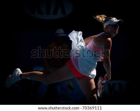 MELBOURNE - JANUARY 27: Li Na of China in her in her semi final win over Caroline  Wozniacki of Denmark in the 2011 Australian Open on January 27, 2011 in Melbourne, Australia - stock photo