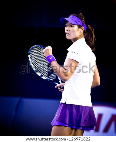 MELBOURNE - JANUARY 26:  Li Na of China in her loss to Victoria Azarenka (R) of Belarus in the 2013 Australian Open Final on January26, 2013 in Melbourne, Australia. - stock photo