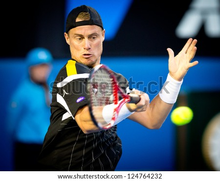 MELBOURNE - JANUARY 14: Lleyton Hewitt of Australia in his first round loss to Janko Tipsarevic of Serbia at the 2013 Australian Open on January 14, 2013 in Melbourne, Australia. - stock photo