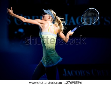 MELBOURNE - JANUARY 22: Maria Sharapova of Russia in her quarter final win over Ekaterina Makarova of Russia at the 2013 Australian Open on January 22, 2013 in Melbourne, Australia. - stock photo