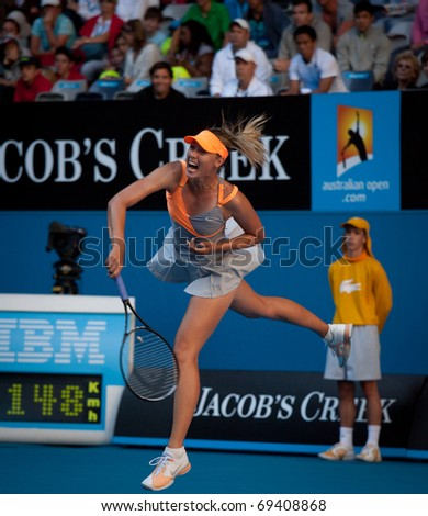 MELBOURNE - JANUARY 19: Maria Sharapova of Russia in her second round win over Virginie Razzano of France in the 2011 Australian Open on January 19, 2011 in Melbourne - stock photo