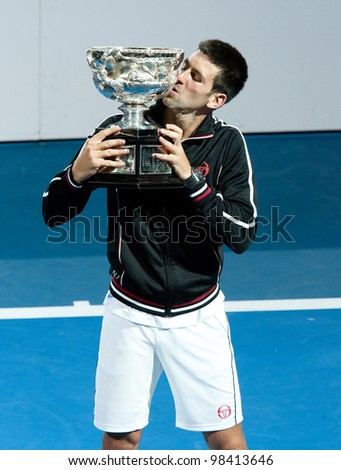 MELBOURNE - JANUARY 29: Novak Djokovic of Serbia after his championship win over Rafael Nadal of Spain at the 2012 Australian Open on January 29, 2012 in Melbourne, Australia. - stock photo