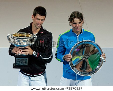 MELBOURNE - JANUARY 29: Novak Djokovic of Serbia (L) after his championship win over Rafael Nadal of Spain (R) at the 2012 Australian Open on January 29, 2012 in Melbourne, Australia. - stock photo