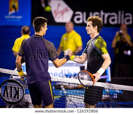 MELBOURNE - JANUARY 27: Novak Djokovic of Serbia (L) in his 2013 Australian Open Championship Final win over Andy Murray of Scotland (R) on January 27, 2013 in Melbourne, Australia. - stock photo