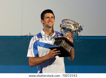 MELBOURNE - JANUARY 30: Novak Djokovic of Serbia winning the 2011 Australian Open final. January 30, 2011 in Melbourne, Australia. - stock photo