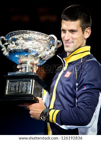 MELBOURNE - JANUARY 27: Novak Djolovic of Serbia with the trophy for winning the 2013 Australian Open on January27, 2013 in Melbourne, Australia. - stock photo