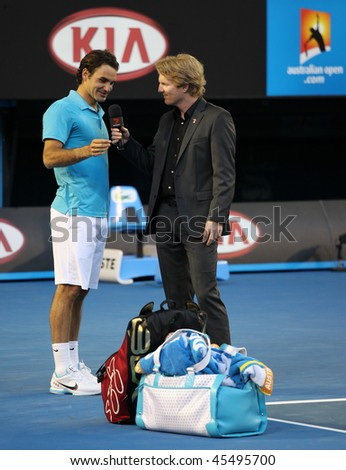 MELBOURNE - JANUARY 27: Roger Federer gives an interview to Jim Courier after his quarter final win over Nikolay Davydenko in the 2010 Australian Open on January 27, 2010 in Melbourne - stock photo