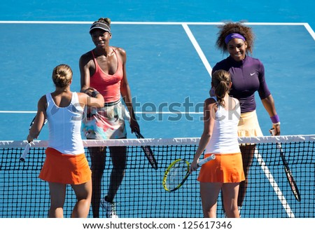 MELBOURNE - JANUARY 22: Sara Errani (L Front) and Roberta Vinci of Italy after their doubles win over Venus and Serena Williams at the 2013 Australian Open on January 22, 2013 in Melbourne, Australia. - stock photo