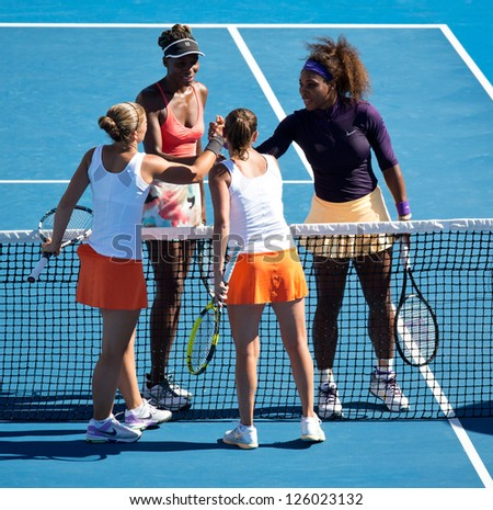 MELBOURNE - JANUARY 22: Sara Errani (L Front) & Roberta Vinci of Italy  after their doubles win over Venus and Serena Williams at the 2013 Australian Open on January 22, 2013 in Melbourne, Australia. - stock photo