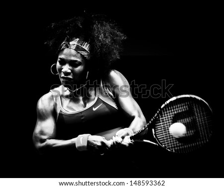 MELBOURNE - JANUARY 17: Serena Williams of the USAin her second round win over Garbine Muguruza of Spain at the 2013 Australian Open on January 17, 2013 in Melbourne, Australia. - stock photo