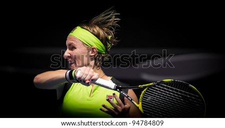 MELBOURNE - JANUARY 21: Svetlana Kuznetsova of Russia in her third round loss to sabine Lisickiof Germany at the 2012 Australian Open on January 21, 2012 in Melbourne, Australia. - stock photo