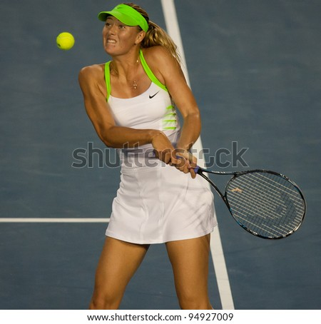 MELBOURNE - JANUARY 28: Victoria Azarenka of Belarus in her championship win over Maria Sharapova of Russia at the 2012 Australian Open on January 28, 2012 in Melbourne, Australia. - stock photo