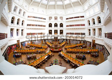 MELBOURNE - July 3, 2014: La Trobe reading room at the State Library of Victoria in Melbourne. The library holds over 2 million books.  It is the central library of the state of Victoria, Australia. - stock photo