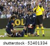 MELBOURNE - MARCH 20: Archie Thompson of Melbourne victory after injuring his knee in the A-League League grand final won by Sydney FC over Melbourne Victory on March 20, 2010 in Melbourne - stock photo
