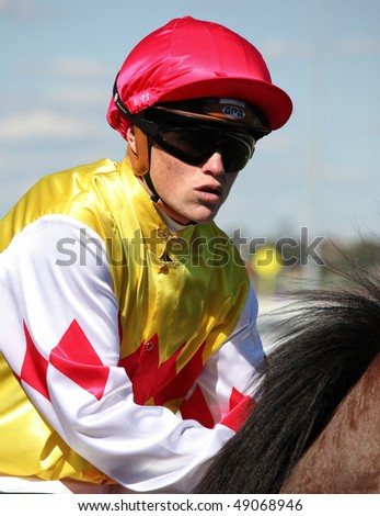 MELBOURNE - MARCH 13: Jockey Craig Williams on Carrara before the start of the Crown Guineas, won by Rock Classic at Flemington on March 13, 2010 - Melbourne, Australia. - stock photo