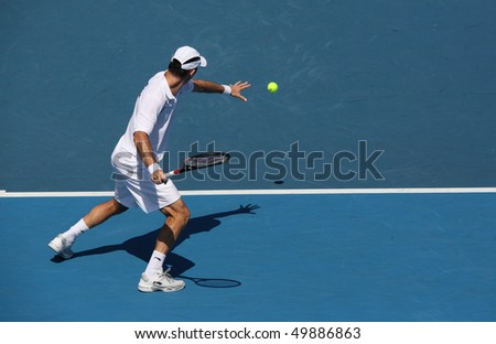 MELBOURNE - MARCH 6: Paul Hanley of Australia hits a forehand in the doubles rubber of the Davis Cup tie against Chinese Taipei on March 6, 2010 in Melbourne - stock photo