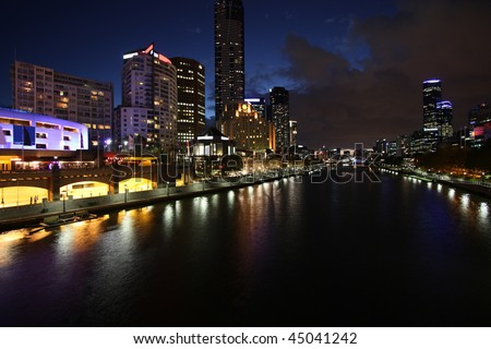 Melbourne night view. Beautiful city of skyscrapers. Yarra River. The prominent building is Eureka Tower, which is the world's tallest residential tower when measured to its highest floor. - stock photo