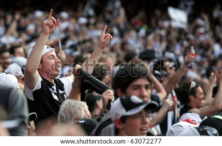 MELBOURNE - OCTOBER 2: Crowd at the Collingwood vs St Kilda AFL Grand Final at the MCG - October 2, 2010 in Melbourne, Australia. - stock photo