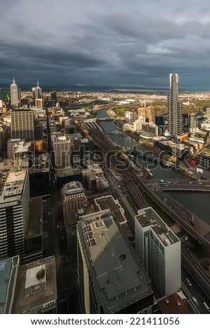 Melbourne panorama at sunset. Panorama of Melbourne from a great height with the river and the railway at sunset.