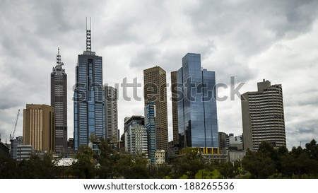 Melbourne's CBD district is seen with clouds gathering overhead.
