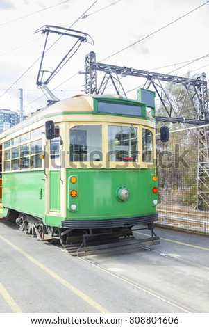 Melbourneâ??s famous, classic green and yellow tram - stock photo