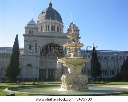 Melbourne's Royal Exhibition Buildings, at dawn. Built in Florentine style, for the 1890 world exhibition. Housed Australia's first federal parliament while Canberra was being built. - stock photo