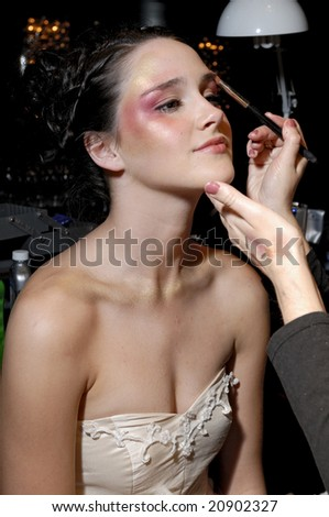 "MELBOURNE - SEPTEMBER 25: A female model wearing garments by Anna Campbell, backstage at ""Seven"" nightclub on September 25, 2008 in Melbourne."