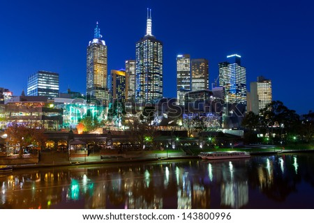 Melbourne skyline towards Fed Square, from Princes Bridge in Victoria, Australia - stock photo