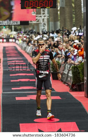 MELBOURNE, VICTORIA, AUSTRALIA - MARCH 23, 2014 - Ironman veteran Craig Alexander of Australia crosses the finish line, on March 23, 2014. This is Alexanders final Ironman. - stock photo