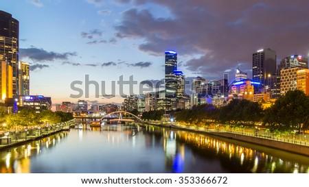 Melburne City, Yarra River with Reflection Cityscape Skyline background under dramatic Golden Sky Sunset at Dusk Twilight, Australia - stock photo