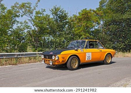 """MELDOLA, FC, ITALY - MAY 31: unidentified driver and co-driver on a vintage Lancia Fulvia Montecarlo (1973) in classic car rally """"Coppa citt� di Meldola"""" on May 31, 2015 in Meldola (FC) Italy  - stock photo"""