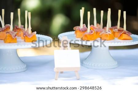 Melon with Iberian smoked ham - stock photo