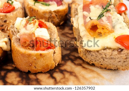Melted cheese on the sandwiches - stock photo