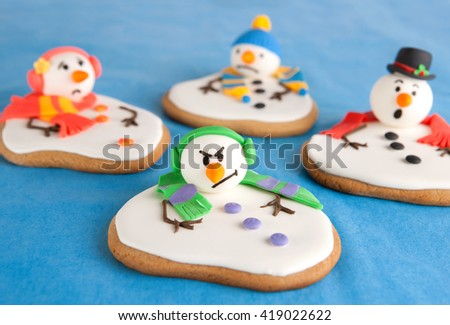 Melted snowman cookies - stock photo