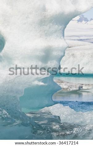 Melting glacial icebergs floating on the Iceberg Lagoon, Jokulsarlon, Iceland - stock photo