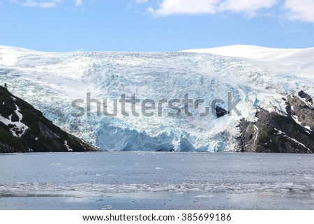 Melting glacier and iceberg in a Global Warming Environment at Gulf of Alaska - stock photo