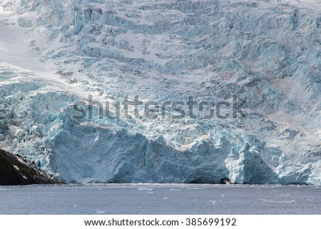 Melting glacier and iceberg in a Global Warming Environment at Gulf of Alaska - stock photo